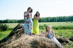 Young beautiful women on hay Royalty Free Stock Photography