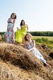 Young beautiful women on hay Royalty Free Stock Image