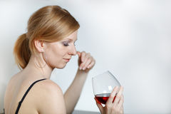 Young beautiful women in lingerie drinking wine Stock Photo