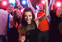 Young beautiful woman at a party. Young beautiful women at a party with friends Stock Photo