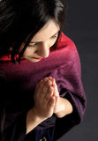 Young and beautiful women praying.  Royalty Free Stock Image