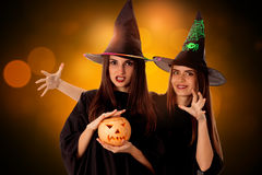 Young beautiful women with pumpkins in hands royalty free stock photos