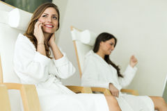 Young and beautiful women relaxing in a spa Stock Photo
