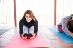 Woman doing yoga workout in class Stock Image