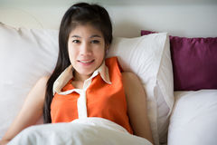 Young Beautiful women sleep on bed Stock Photo