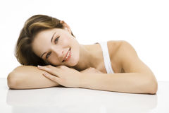 Young beautiful women smiles. Young beautiful woman with a relaxed smile towards the camera Stock Image