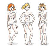 Young beautiful women standing in white underwear. Vector set of Royalty Free Stock Image