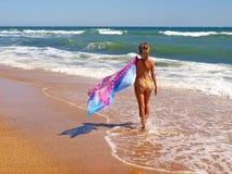 Young beautiful women on the sunny beach in bikini Stock Images