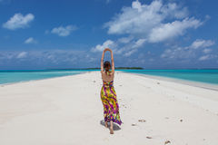 Young beautiful women on the sunny tropical beach Stock Photos