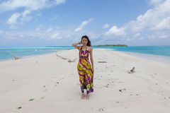 Young beautiful women on the sunny tropical beach Royalty Free Stock Photo