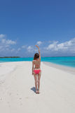 Young beautiful women on the sunny tropical beach Stock Photography