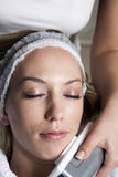 Young Beautiful Women on the Treatment in the Spa Stock Photography