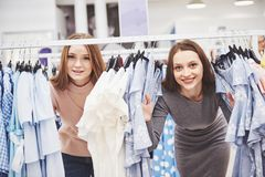 Young beautiful women at the weekly cloth market - Best friends sharing free time having fun and shopping in the old royalty free stock photos
