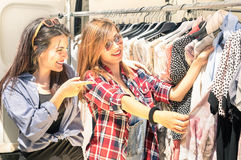 Young beautiful women at the weekly cloth market royalty free stock photography