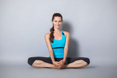 Young beautiful yoga posing Stock Photos