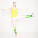 Young beautiful yoga posing Royalty Free Stock Image
