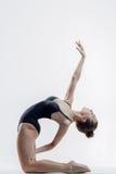 Young beautiful yoga posing in studio Royalty Free Stock Image