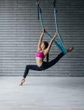 Young beautiful yoga posing in studio Royalty Free Stock Images