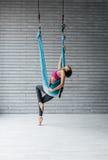 Young beautiful yoga posing in studio Royalty Free Stock Photos
