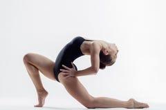 Young beautiful yoga posing in studio Stock Photo