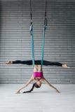 Young beautiful yoga posing in studio Royalty Free Stock Photo