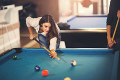 Young beautiful young woman aiming to take the snooker shot Royalty Free Stock Photography