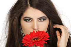 Young beautiful young woman with gerbera Royalty Free Stock Photography