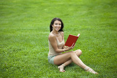 Young beautiful young woman reading a book outdoor Stock Photo