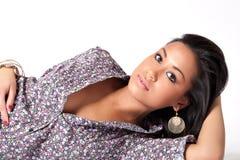 Young Beautifull African Woman Lying Down Flirting Stock Photography