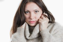Young beautifull woman in big warm sweater. Portrait of young beautifull woman in big warm sweater isolated on white Royalty Free Stock Photo