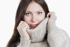 Young beautifull woman in big warm sweater. Portrait of young beautifull woman in big warm sweater isolated on white Royalty Free Stock Photos