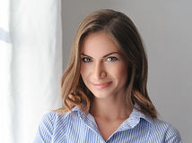 Young beautifull woman in blue shirt with sexy pink lips. Stock Image