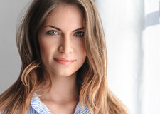 Young beautifull woman in blue shirt with sexy pink lips. Stock Photography