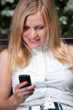 Young beautifull woman with cell phone. Royalty Free Stock Images