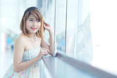 Young beautifull woman stand near glass wall in office Stock Photo