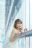 Young beautifull woman stand near glass wall in office Stock Image