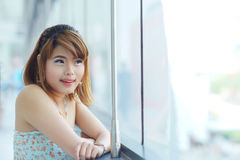 Young beautifull woman stand near glass wall in office Royalty Free Stock Images