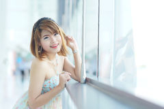 Young beautifull woman stand near glass wall in office Royalty Free Stock Photo
