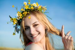Young beauty. An image of a young girl in a circlet of flowers Stock Photography