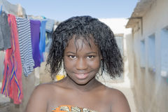 Young beauty in an African shanty town Stock Photo
