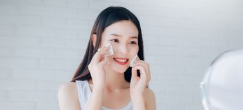 Young Beauty Asian Woman Cleaning Face with Cotton Clear Face stock photo