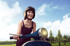 The young beauty of Asian women riding a scooter royalty free stock photo