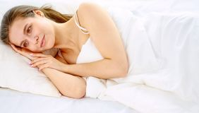 Young beauty asleep in a white bed.  Royalty Free Stock Image