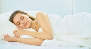 Young beauty asleep in a white bed.  Stock Photography