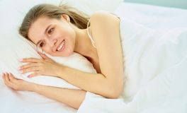 Young beauty asleep in a white bed.  Stock Photos