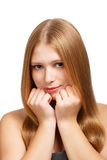 Young beauty. Young beautiful woman with long blond hair posing isolated on white background Royalty Free Stock Images