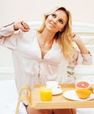 Young beauty blond woman having breakfast in bed early sunny mor. Ning, princess house interior room, lifestyle people concept Stock Images