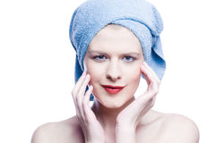 Young beauty with blue towel around her head Stock Photos