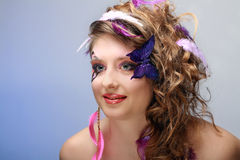 Young beauty with butterfly face-art Stock Photography