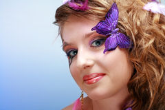 Young beauty with butterfly face-art Royalty Free Stock Photos